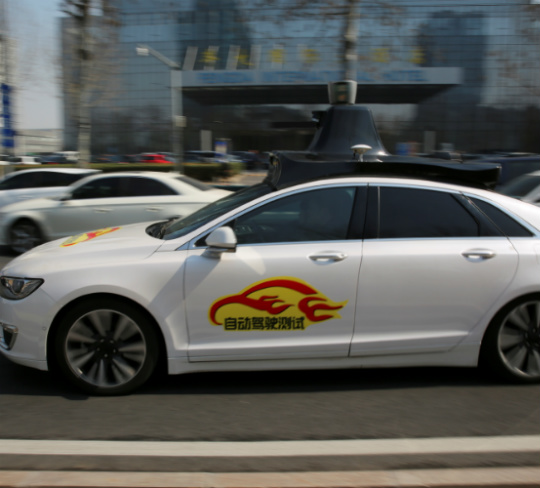 Baidu's Apollo autonomous vehicle during a public road test for self-driving vehicles in Beijing. REUTERS.