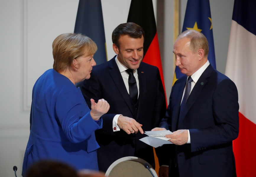 German Chancellor Angela Merkel, French President Emmanuel Macron, and Russian President Vladimir Putin. REUTERS.