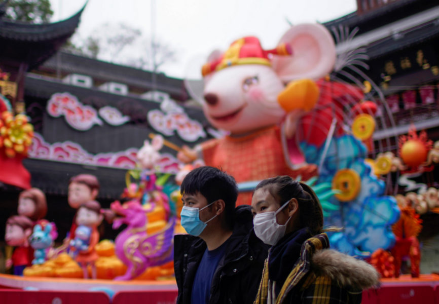 People in Shanghai wearing masks during the Chinese Lunar New Year holiday as the country grapples with the coronavirus outbreak. REUTERS.