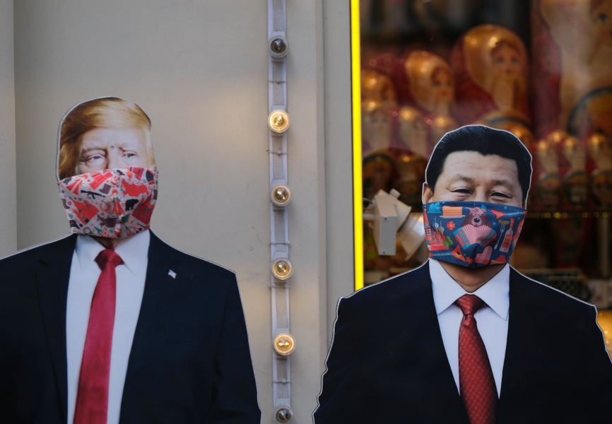 Cardboard cutouts of US President Donald Trump and Chinese President Xi Jinping wearing face masks. REUTERS.