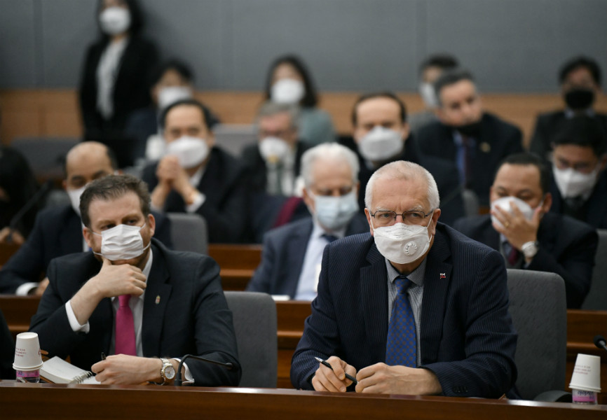 Foreign diplomats attend a briefing on coronavirus by South Korean Foreign Minister Kang Kyung-wha. REUTERS.
