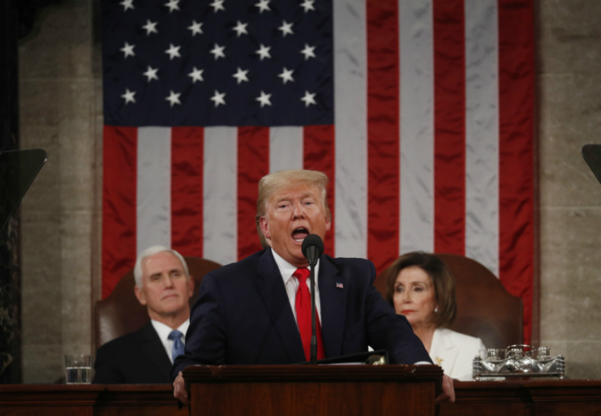 US President Donald Trump, Speaker of the House Nancy Pelosi, and Vice President Mike Pence at the 2020 State of the Union. REUTERS.